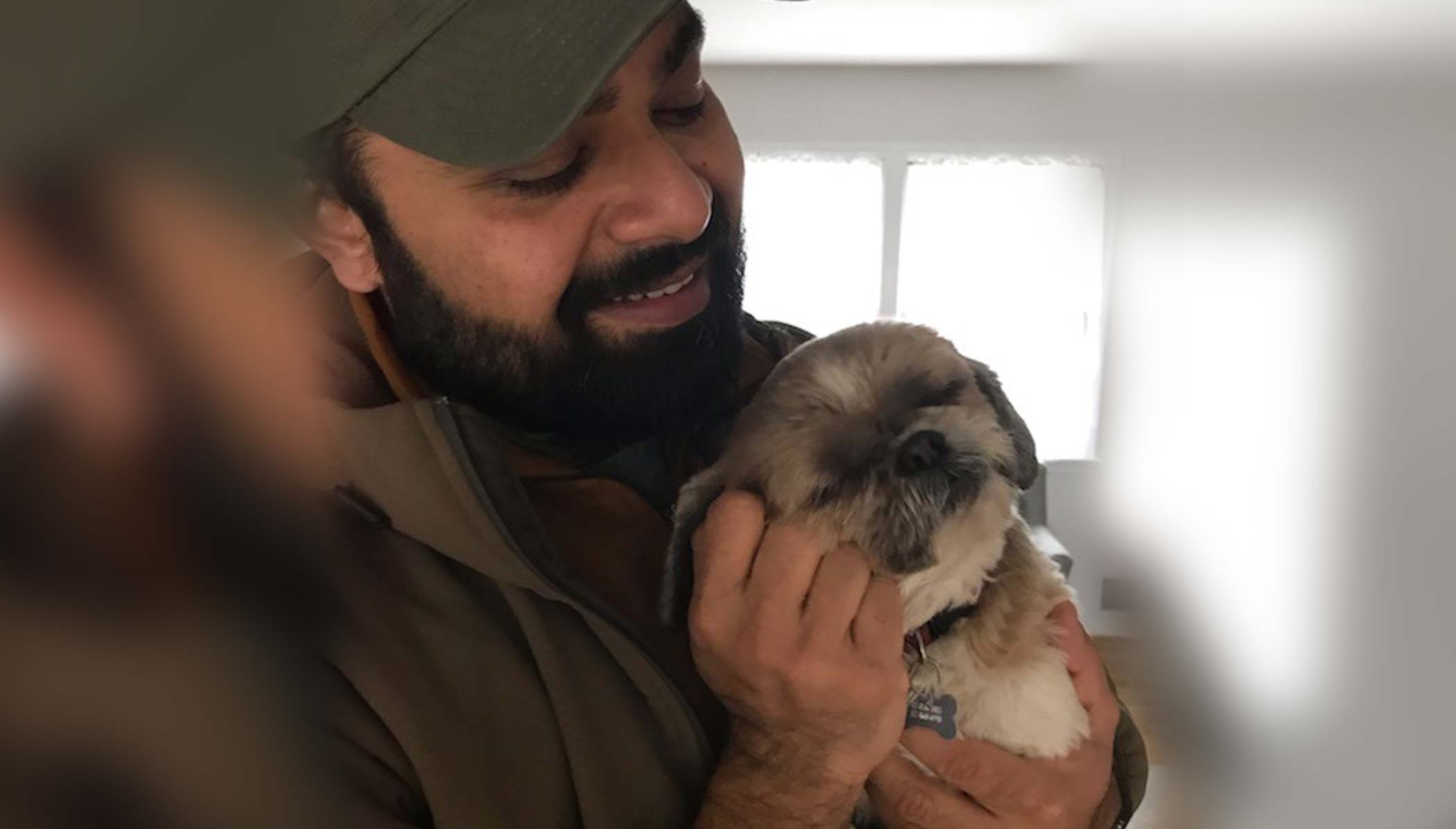 Mohammad Husain, V-Soft Consulting Senior technical recruiter Harrisburg office with his shih tzu