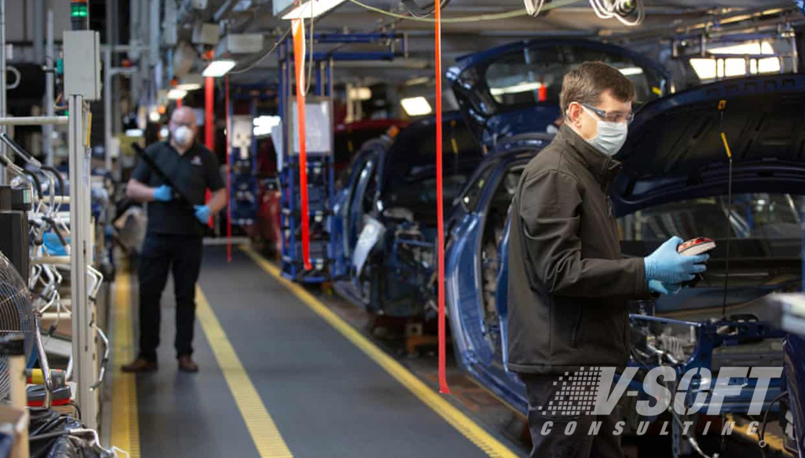 Employees Performing Assembly in Automobile Industry