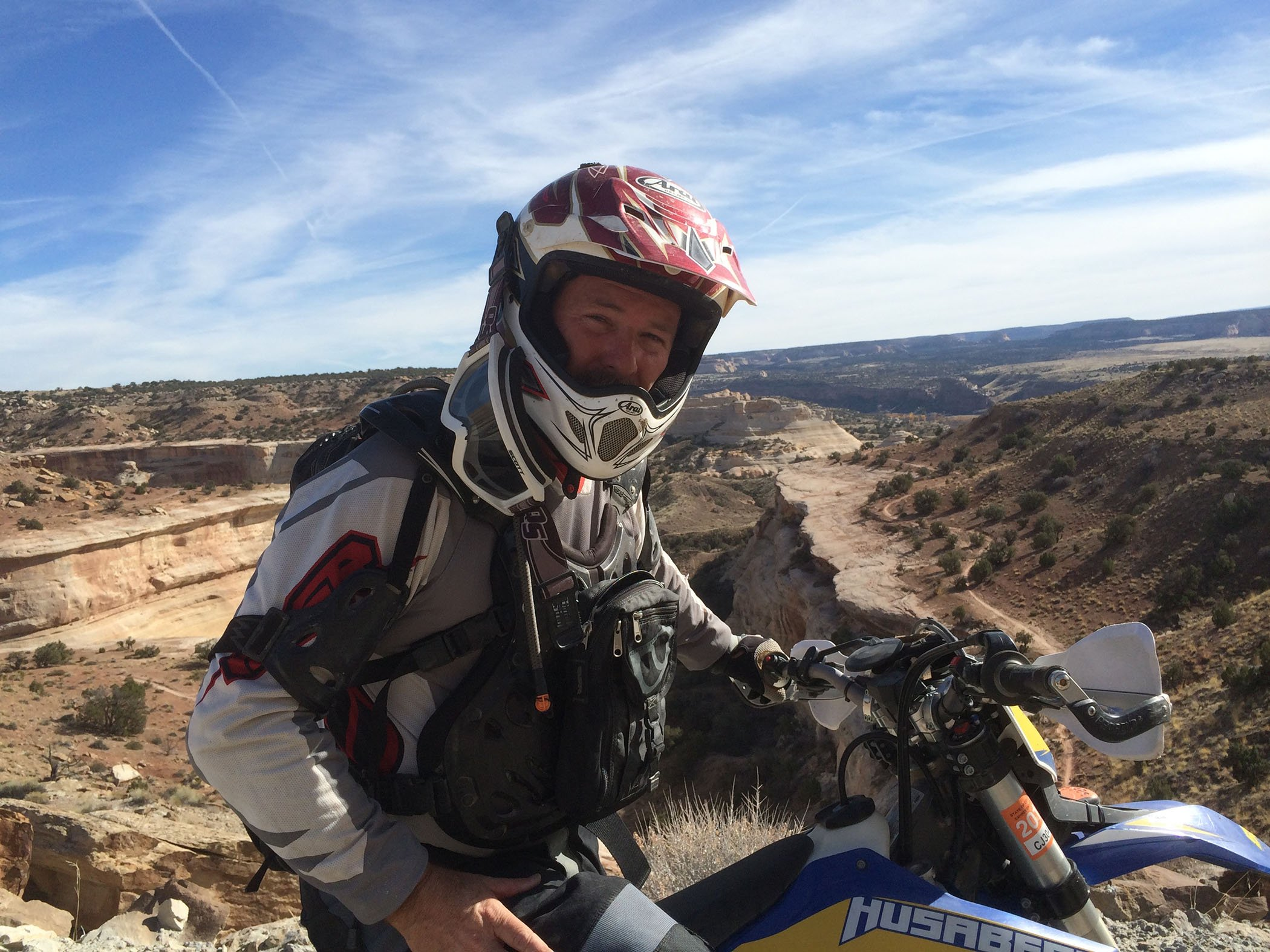 Greg Loftin, our Service Now Expert sits on his dirt bike in Denver.