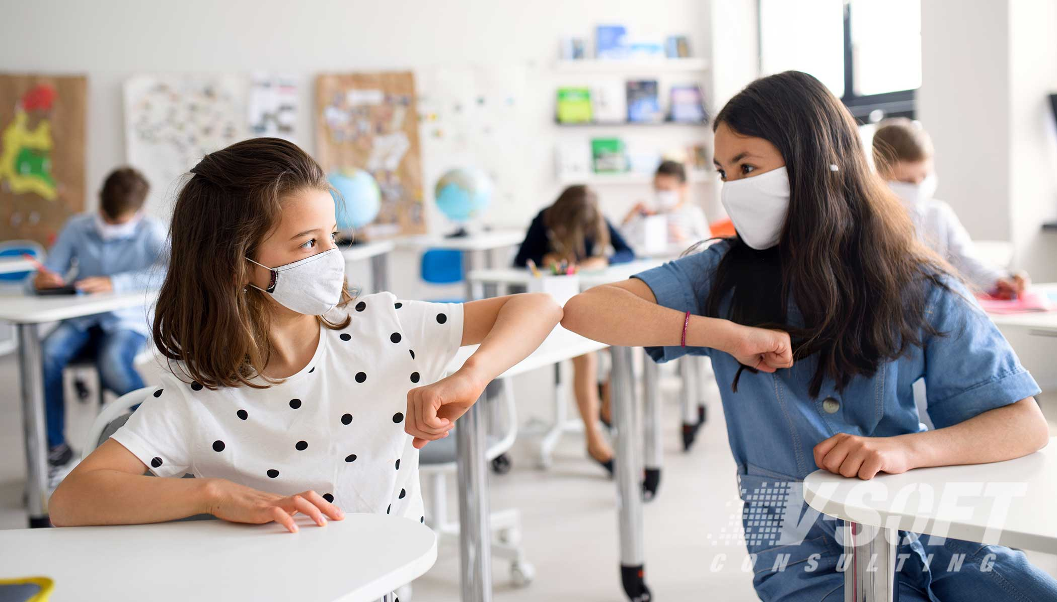 School children returning to classroom with masks