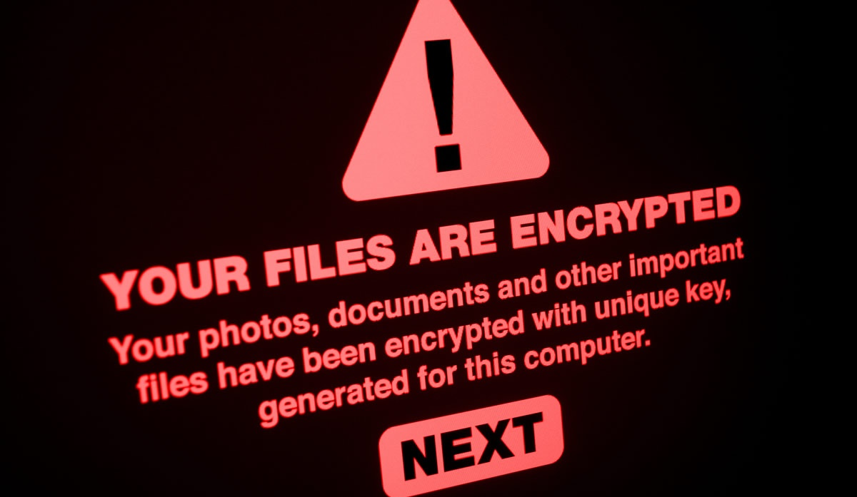 Encrypted computer screen threats cybersecurity ransomware SIZED