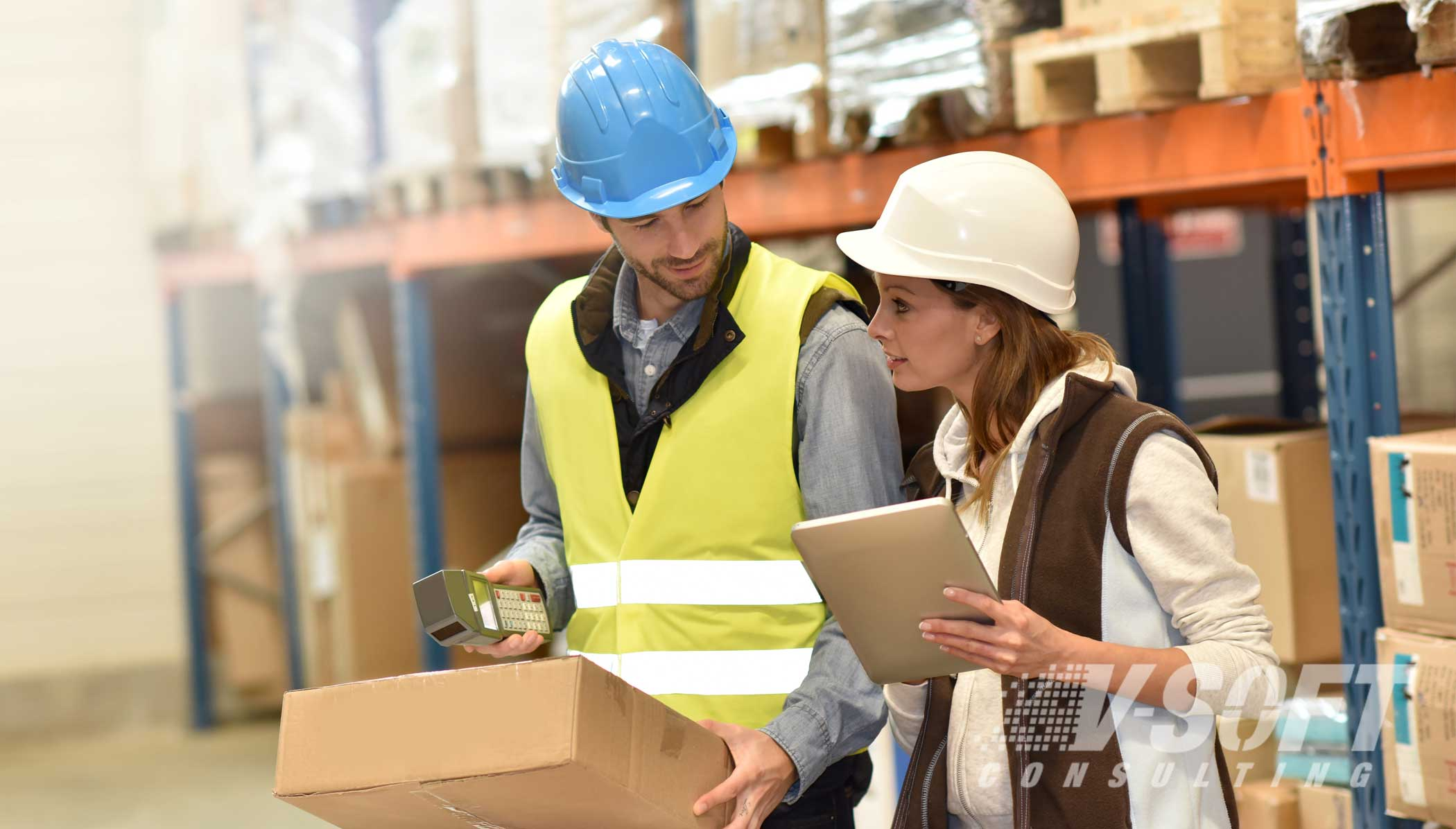 Warehouse workers using mobile app for logistics