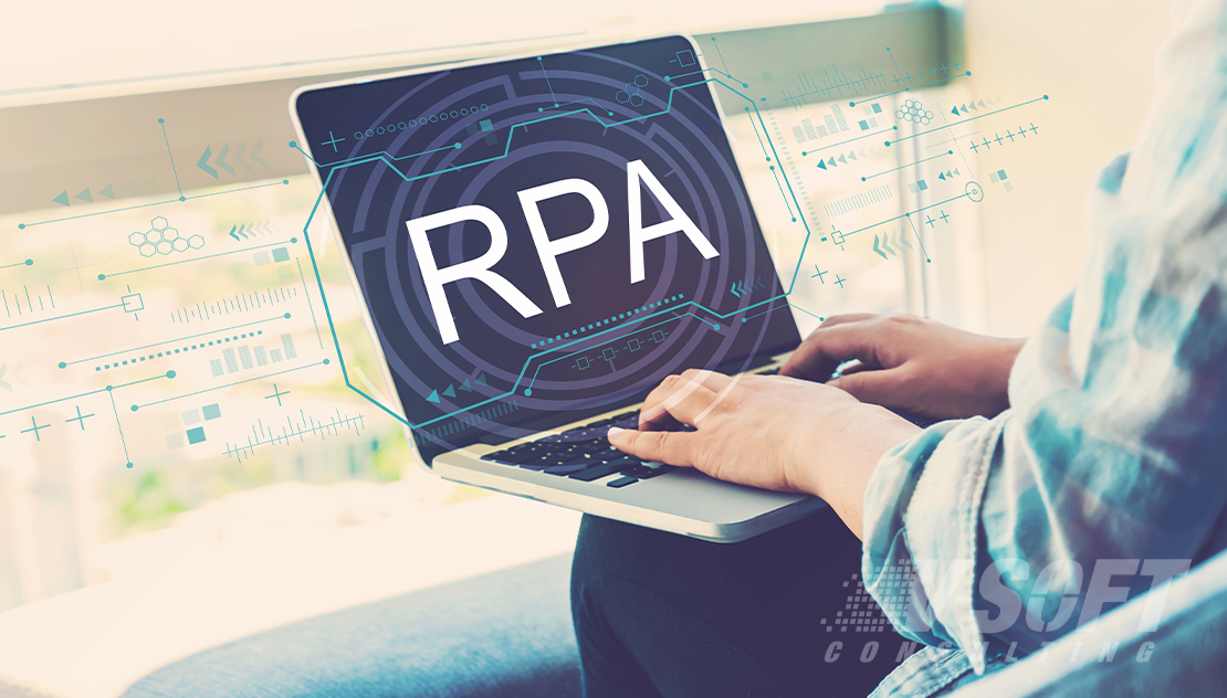 Service Matter Expert working on RPA Pilot on Laptop